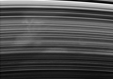 A broad and ghostly spoke drifts past under the Cassini spacecraft's gaze. The spoke-forming region of the B ring displays faint longitudinal variations in brightness, from left to right