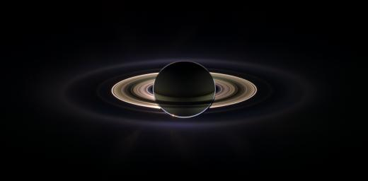 With giant Saturn hanging in the blackness and sheltering NASA's Cassini from the sun's blinding glare, the spacecraft viewed the rings as never before, revealing previously unknown faint rings and even glimpsing its home world.