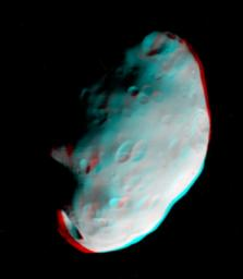 Craters on Saturn's moon Pandora exhibit clarity and depth in this anaglyph from NASA's Cassini spacecraft. 3D glasses are necessary to view this image.