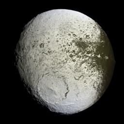NASA's Cassini spacecraft captures a high-resolution glimpse of the bright trailing hemisphere of Saturn's moon Iapetus.