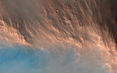 This image from NASA's Mars Reconnaissance Orbiter reveals an impact crater, nine kilometers in diameter, with a central peak. Impact craters of various sizes and ages can be found across the Martian surface.