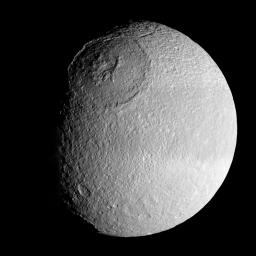 The vast expanse of the crater Odysseus spreads out below NASA's Cassini spacecraft in this mosaic view of Saturn's moon Tethys. Tethys is 1,071 kilometers (665 miles) across.