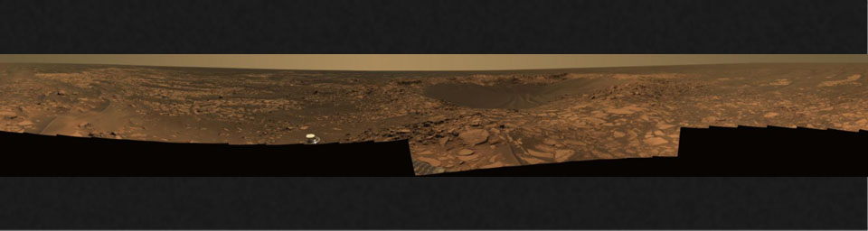 This 360-degree view taken in August, 2006, shows Opportunity's last stop on surface of Meridiani Planum. At center of the mosaic is 'Beagle Crater,' an impact crater. Opportunity's tracks are visible approaching the crater.