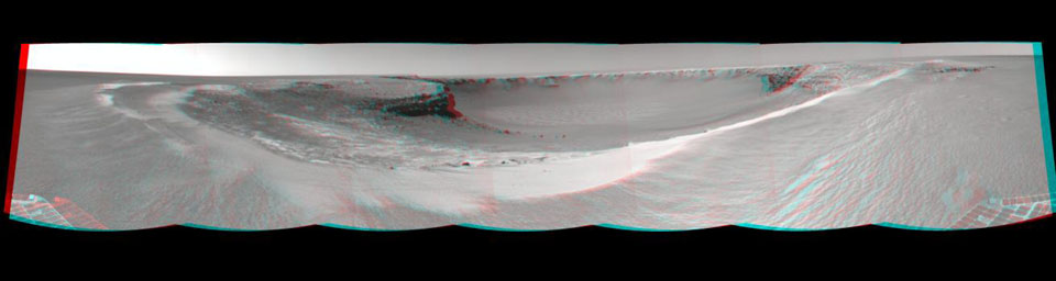 NASA's Mars rover Opportunity edged closer to the top of the 'Duck Bay' alcove along the rim of 'Victoria Crater' (overnight Sept. 27 to Sept. 28), and gained this vista of the crater. 3D glasses are necessary to view this image.