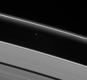 Prometheus interacts gravitationally with the inner flanking ringlets of the F ring, creating dark channels as it passes