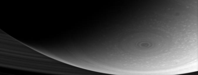 This dramatic close-up of Saturn's south pole shows the hurricane-like vortex that resides there. The entire polar region is dotted with bright clouds, including one that appears to be inside the central ring of the polar storm