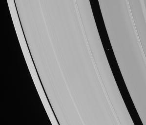 Saturn's ring-embedded moons, Pan and Daphnis, are captured in an alignment they repeat with the regularity of a precise cosmic clock