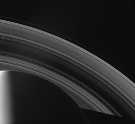 The Cassini spacecraft looks across Saturn's cloud-dotted north and shadowed pole, and out across the lanes of ice that compose its rings