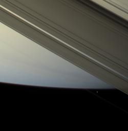 The F ring shepherd moon Prometheus touches the face of Saturn once more before moving off into blackness and continuing in its orbit. Images were obtained by NASA's Cassini spacecraft's narrow-angle camera on April 13, 2007.
