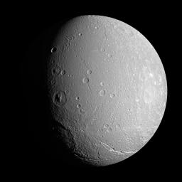 NASA's Cassini spacecraft investigates the craters and deep valleys on Dione during a close approach in April 2007.