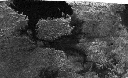 This radar image, obtained by NASA's Cassini radar instrument during a near-polar flyby on Feb. 22, 2007, shows a big island smack in the middle of one of the larger lakes imaged on Saturn's moon Titan.