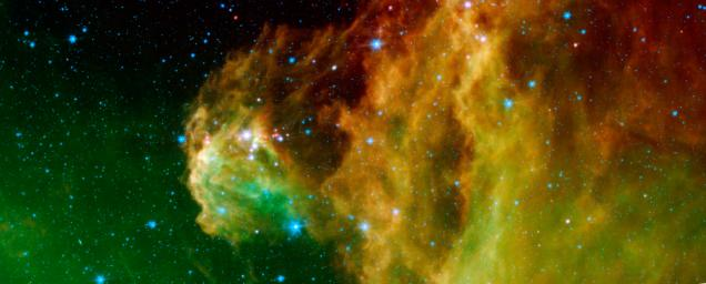 This image from NASA's Spitzer Space Telescope shows infant stars 'hatching' in the head of the hunter constellation, Orion. The region featured in this Spitzer image is called Barnard 30.