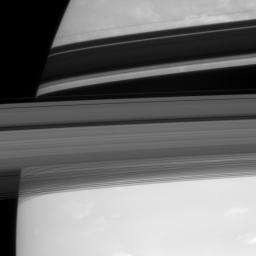 Saturn's rings cut across their own shadows on the planet and hide a tiny secret. Barely visible in the Encke Gap is the embedded moon Pan in this image captured by NASA's Cassini spacecraft on Sept. 18, 2007.