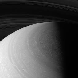 As seasons change on Saturn, and sunlight creeps farther north, the region surrounding the north pole is steadily coming to light. This image was captured by NASA's Cassini spacecraft's wide-angle camera on Jan. 2, 2008.