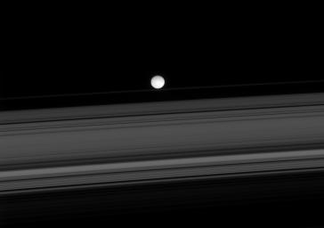 On Dec. 2, 1007, NASA's Cassini spacecraft spied two of Saturn's small moons, Atlas and Epimetheus, that skirt the edges of the planet's rings.