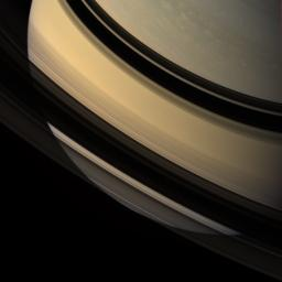 Saturn's southern hemisphere is glimpsed through the gossamer veil of its rings. Ring shadows adorn the low northern latitudes. This image was acquired with NASA's Cassini spacecraft's wide-angle camera on Dec. 16, 2007.