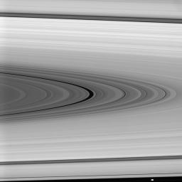 On Jan. 29, 2008, NASA's Cassini spacecraft examined the Maxwell Gap, the large, dark division at center, which is surrounded on either side by the broad, isolated and bright ring regions, or 'plateaus,' of Saturn's outer C ring.
