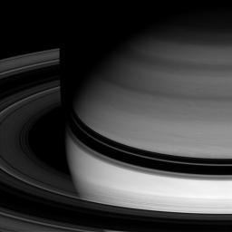 Saturn's semitransparent rings arc smoothly around the gas giant, abruptly disappearing where they pass through the planet's shadow are captured in this image from NASA's Cassini spacecraft taken on Apr. 15, 2008.