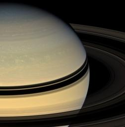 Stately Saturn sits surrounded by its darkened disk of ice. An increasing range of hues has become visible in the northern hemisphere as spring approaches and the ring shadows slide southward