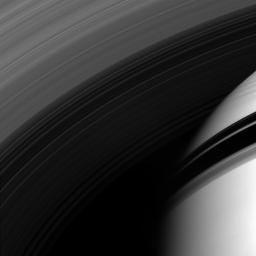 NASA's Cassini spacecraft peers through the gossamer strands of Saturn's innermost rings, whose own shadows adorn the planet beyond.