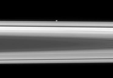 The flattened, potato-like form of Prometheus gliding silently within the Roche Division, between Saturn's A and F rings was captured by NASA's Cassini spacecraft on May 2, 2008.