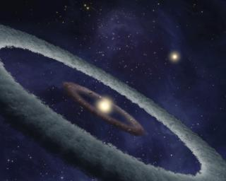 This artist's conception shows a binary-star, or two-star, system, called HD 113766, where astronomers suspect a rocky Earth-like planet is forming around one of the stars.
