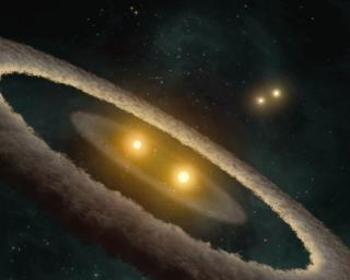 This artist concept based on data from NASA' Spitzer Space Telescope, depicts a quadruple-star system called HD 98800. The system is approximately 10 million years old, and is located 150 light-years away in the constellation TW Hydrae.