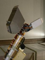 This four-spike tool, called the thermal and electrical conductivity probe, is in the middle-right of this photo, mounted near the end of the arm near NASA's Phoenix Mars Lander scoop (upper left).