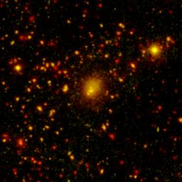 NASA's Spitzer Space Telescope spotted a four-way collision, or merger, in a giant cluster of galaxies, called CL0958+4702, located nearly five billion light-years away.