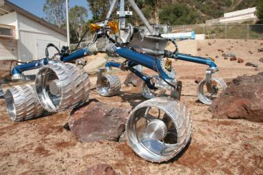 Scarecrow, a mobility-testing model for NASA's Mars Science Laboratory, easily traverses large rocks in the Mars Yard testing area at NASA's Jet Propulsion Laboratory.