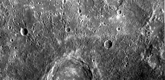 The image shows part of a large, fresh crater with secondary crater chains located near Mercury's equator on the side of the planet newly imaged on January 14, 2008 by NASA's MESSENGER spacecraft.