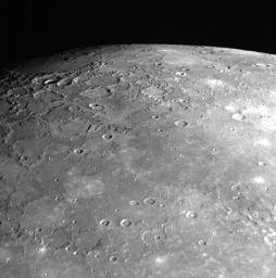 As NASA's MESSENGER spacecraft sped by Mercury on January 14, 2008, the Narrow Angle Camera (NAC) of the Mercury Dual Imaging System (MDIS) captured this shot looking toward Mercury's north pole.