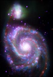 A composite image of M51, also known as the Whirlpool Galaxy, shows the majesty of its structure in a dramatic new way through several of NASA's orbiting observatories.