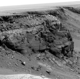 NASA's Mars Exploration Rover Opportunity rover spent 2006 and 2007 traversing the rim of Victoria Crater.The rover obtained images of rock outcrops exposed at several cliffs along the way. The cliff in this image is dubbed Cape St. Vincent.