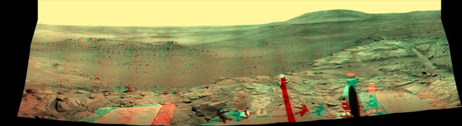 NASA'S Mars Exploration Rover Spirit captured this westward view from atop a low plateau where Sprit spent the closing months of 2007. 3D glasses are necessary to view this image.