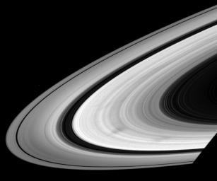 As they wheel about the planet, Saturn's sunlit rings often exhibit dark, radial markings called spokes. This image was captured by NASA's Cassini spacecraft on June 3, 2008.