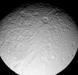 Powerful forces ripped apart the surface of Saturn's moon Tethys at some time in the deep past, creating the incredible canyon system of Ithaca Chasma. This image was captured by NASA's Cassini spacecraft on July 28, 2008.