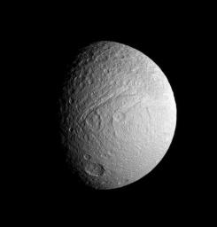 NASA's Cassini spacecraft provides a view of the southern portion of Tethys' trailing hemisphere. Prominent features include the huge canyon, Ithaca Chasma, as well as Demodocus and Telemus, large basins just to the right of the rift.