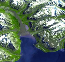 Longyearbyen is the administrative center of Svalbard and is located on Spitsbergen, the largest island of the Svalbard archipelago, part of the Kingdom of Norway. NASA's Terra satellite captured this image on July 12, 2003.