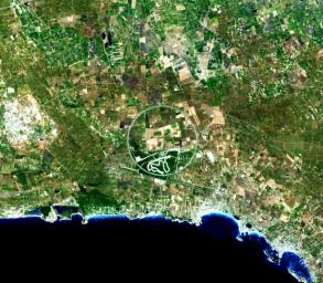 The Nardò Ring is a striking visual feature from space, and astronauts have photographed it several times. The Ring is a race car test track in Italy. This image was acquired by NASA's Terra satellite on August 17. 2007.