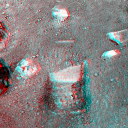 This anaglyph image, acquired by NASA�s Phoenix Lander�s Surface Stereo Imager on June 1, 2008, shows a stereoscopic 3D view of the so-called 'Knave of Hearts' first-dig test area to the north of the lander. 3D glasses are necessary to view this image.