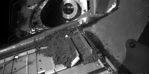 Martian Soil Delivery to Analytical Instrument on Phoenix