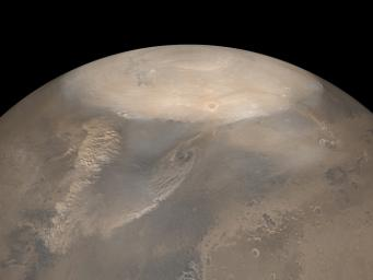 NASA's Mars Global Surveyor shows choppy dust clouds of at least three dust storms on Mars. The white polar cap is frozen carbon dioxide.