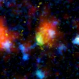 The green and red splotch in this image is the most active star-making galaxy in the very distant universe. Nicknamed 'Baby Boom,' it was spotted 12.3 billion light-years away by a suite of telescopes, including NASA's Spitzer Space Telescope.