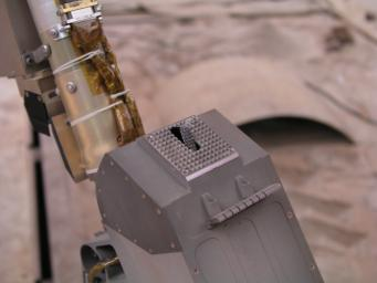 This close-up photograph taken at the Payload Interoperability Testbed at the University of Arizona, Tucson, shows the motorized rasp protruding from the bottom of the scoop on the engineering model of NASA's Phoenix Mars Lander's Robotic Arm.