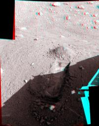 This anaglyph, acquired by NASA's Phoenix Lander's Surface Stereo Imager on June 19, 2008, shows a view of the Martian surface near the lander. The trench shown here is informally called 'Snow White 1.' 3D glasses are necessary.