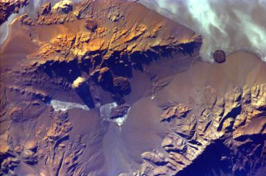 The Andes Mountains, part of the Southern Cordillera formed from subduction zone volcanism at the convergent boundary of the Nazca plate and the South American plate. This image is from NASA's EarthKAM.