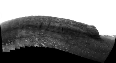 This image from NASA's Mars Exploration Rover Opportunity taken July, 2008 shows gull-shade lighting in late Martian afternoon of the layered cliff face of 'Cape Verde' promontory making up part of the rim of Victoria Crater in the Meridiani Planum.