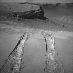 NASA's Mars Exploration Rover Opportunity climbed out of 'Victoria Crater' following the tracks it had made when it descended into the bowl nearly a year earlier in this image taken on Aug. 28, 2008.