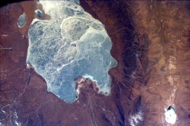 This image from NASA's EarthKAM captures almost all of Quinghai, the largest lake in China. It is located in the Quinghai Province on the Quinghai Tibetan Plateau.